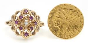 A Yellow Gold Indian Coin Ring  14 Karat Yellow Gold Ruby and Diamond Ring