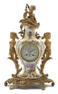 A Bronze Mantle Clock with Sevres Style Insets Retailed by