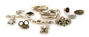 A Collection of Sterling Silver and Gold Jewelry
