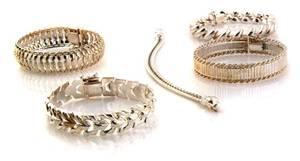 A Group of Five Sterling Silver Bracelets