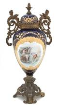 A Sevres Style Gilt Metal Mounted Vase