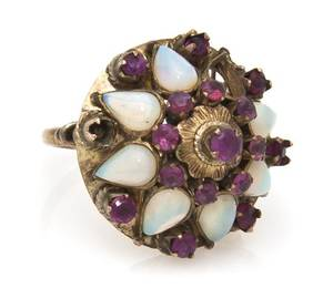 A 14 Karat Yellow Gold Ruby and Opal Cluster Ring