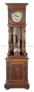 A Victorian Walnut Tall Case Clock