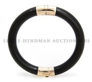 A 14 Karat Yellow Gold and Black Jadeite Bangle Bracelet