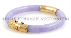 A 14 Karat Yellow Gold and Lavender Jadeite Hinged Bangle Bracelet