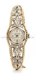 A 14 Karat Two Tone Gold and Diamond Bracelet Watch Longines