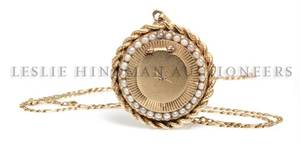 A 14 Karat Yellow Gold Cultured Pearl Locket