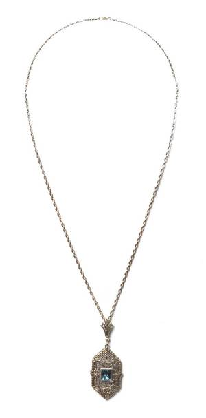 A 14 Karat White Gold Seed Pearl and Synthetic Spinel Pendant
