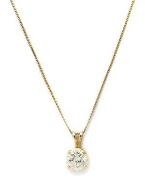 A 14 Karat Yellow Gold and Diamond Solitaire Pendant