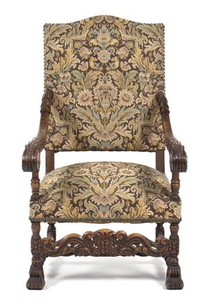 A Henry II Style Carved Walnut Open Armchair