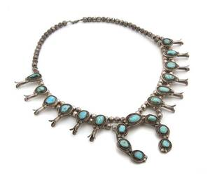 A Native American Silver and Turquoise Squash Blossom Necklace