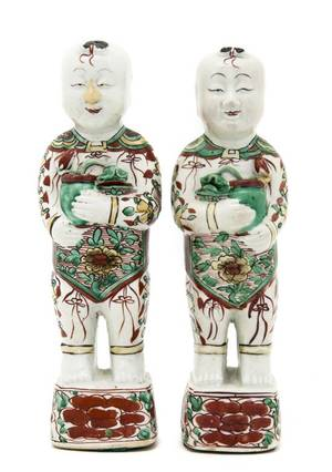 A Pair of Chinese Porcelain Figures of Standing Boys