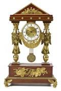 An Empire Gilt Bronze Mounted Mahogany Portico Form Mantel Clock