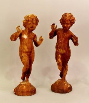 Pair of Cast Iron Wingless Putti Figures