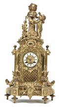 A French Gilt Bronze Figural Mantel Clock