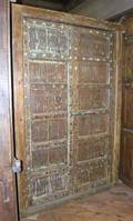 A North Indian Iron Mounted Teak Paneled Double Door with Jamb