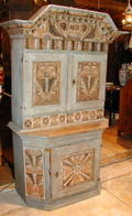A Swedish Allmoge Painted Stepback Marriage Cupboard