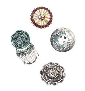 A Collection of Four Southwestern Sterling Silver Brooches
