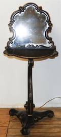 An Ebonized and Giltwood Shaving Stand