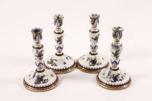 Set of Four French Porcelain Candlesticks
