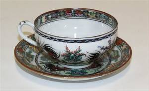 A Set of Eight Chinese Cups and Saucers