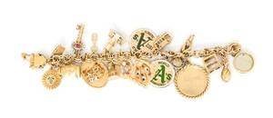 A 14 Karat Yellow Gold Charm Bracelet with 19 Attached Charms