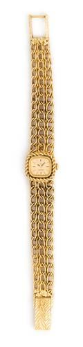 An 18 Karat Yellow Gold Wristwatch Omega