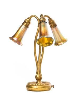 A Tiffany Studios Dore Bronze and Gold Favrile Glass ThreeLight