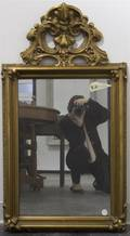 A Baroque Style Giltwood Mirror