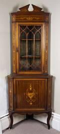 An English Marquetry Inlaid Mahogany Corner Cupboard