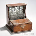 Edwardian Brassmounted Oak Tantalus with a mirrored back and single drawer housing a pair of colorless glass decanters ht 10 12 w