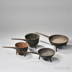 Two Cast Iron Footed Skillets and Two Cast Iron Posnets