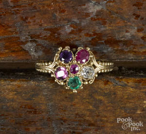 14K yellow gold ring with a flowershaped cluster of various gemstones