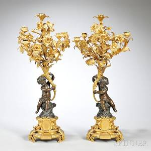 Pair of Louis XVstyle Patinated Bronze and Ormolu Candelabra