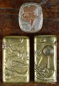 Two Japanese embossed brass match vesta safes