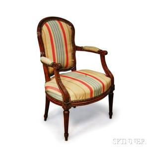 Louis XVIstyle Carved Walnut Fauteuil