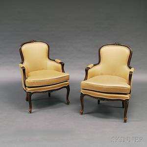 Pair of French Provincialstyle Carved Fruitwood Bergeres