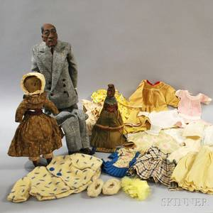Three AfricanAmerican Dolls and Miscellaneous Doll Clothing