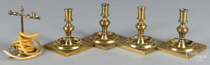 Four English brass candlesticks