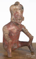 Colima preColumbian pottery vessel in the form of a seated man with his hands on his knees