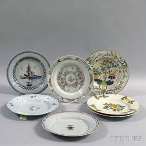 Seven Polychrome Tinglazed Plates