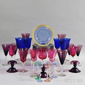 Fortytwo Pieces of Colored Glass Tableware