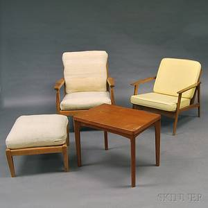 Two Danish Modern Lounge Chairs an Ottoman and a Side Table