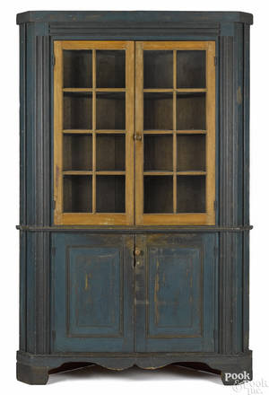 Pennsylvania painted pine and poplar onepiece corner cupboard ca 1800