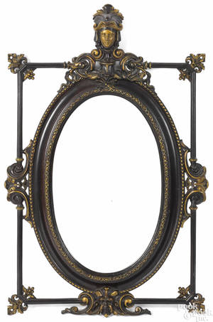 Paint and gilt decorated cast iron mirror