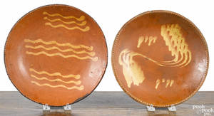 Two Pennsylvania redware chargers 19th c
