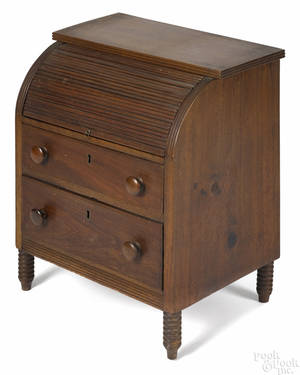 Miniature Sheraton walnut roll front desk ca 1835