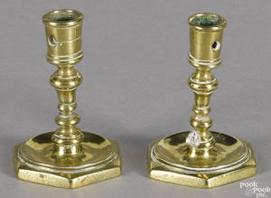 Pair of brass octagonal base taperstick holders early 18th c