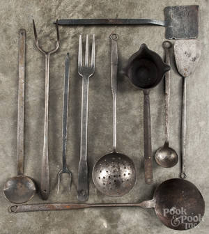 Ten wrought iron long handled utensils