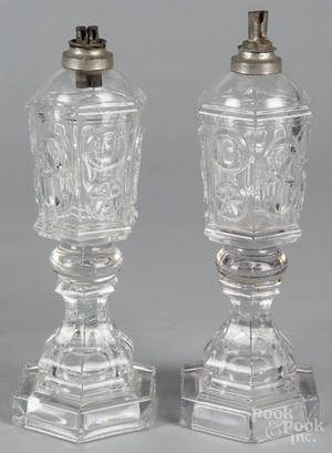 Pair of colorless Sandwich glass fluid lamps